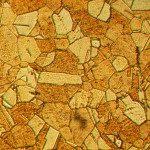 Microstructure_of_rolled_and_annealed_brass;_magnification_400X